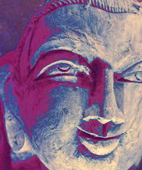 Indigo Gaze (Suddun Frames) Tags: light shadow portrait sculpture stilllife art smile face heaven artist nirvana buddha indigo stare bliss gaze woodensculpture smilingbuddha emotionalstillness
