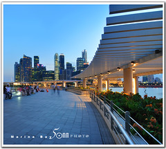 Singapore marina bay (fiftymm99) Tags: city bridge urban reflection water museum marina river lights one restaurant hotel bay pier nikon singapore cityscape waterfront may bank tourist casino business esplanade cbd sands clifford standard fullerton ntuc d300 marinabay uob singaporeskyline charted artscience marinabaysands fiftymm99 whereintheworldiswally