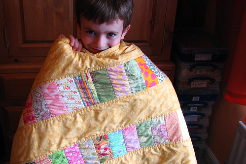waif with baby quilt