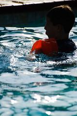 Kid in the Pool (Blake Coble) Tags: california boy ontario water pool silhouette swimming swim kid nikon child play july naturallight ripples 4thofjuly floaties d90