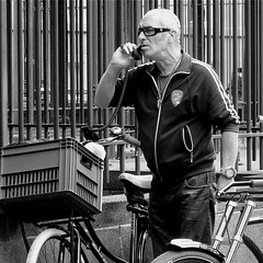 CALL FOR THE NIGHT MAJOR (Akbar Simonse) Tags: street people urban holland netherlands bicycle candid telephone streetphotography denhaag thehague telefoon fiets streetshot iphone straat straatfotografie straatfoto nightmayor straatfotograaf renebom dedoka nachtburgermeester akbarsimonse nachburgemeester dehaagsebom