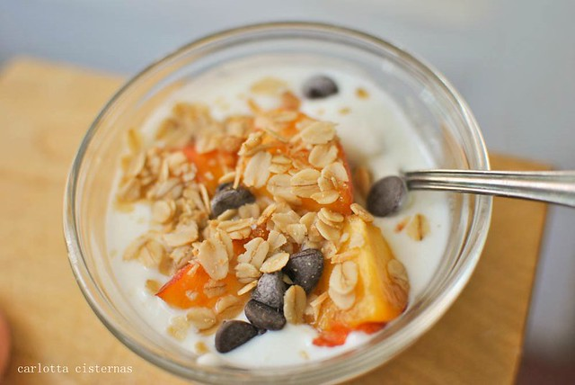 yogurt with granola, chocolate chips, and peaches