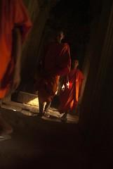 Tha Phrom Monks (Madeline Brenner) Tags: old travel orange stone religious temple ancient ruins asia cambodia southeastasia shadows religion international monks abroad angkor saffron siemriep thaphrom