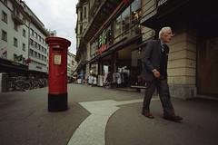 in the city III (don_philippe) Tags: old red man rot film analog mailbox schweiz switzerland post kodak fb bessa luzern rangefinder wideangle letterbox 135 r3a expired lucerne voigtländer briefkasten weitwinkel superwideheliar abgelaufen farbwelt messsucher