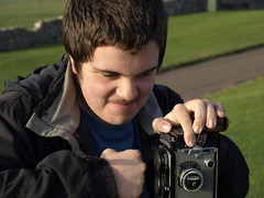Josh Says I Take Too Many Pictures (cycle.nut66) Tags: camera portrait tlr glass face up rollei rolleiflex lens t island four reflex joshua joke twin son olympus josh holy northumberland northumbria punch fed zuiko lindisfarne hold thirds evolt e510 tessar lanthanum