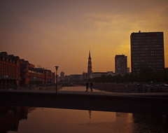 the golden hour // hamburg (pamela ross) Tags: city bridge light people urban sun building church water pen river germany golden europe view hamburg olympus hour speicherstadt ep1 17mm mft nikolaifleet