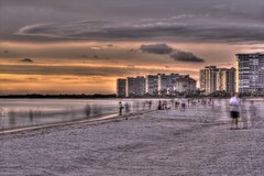 Marco Island Busy Beach (johnmiseroy) Tags: ocean pink blue sunset orange color beach beautiful yellow canon landscape photography eos purple filter hdr 28300mm marcoisland photomatix tonemapping singhray t2i varintrio