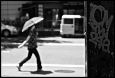 foregone conclusions (MdKiStLeR) Tags: street urban bw woman japan umbrella photography graffiti tokyo asia shadows dof bokeh candid shibuya pole foregoneconclusions