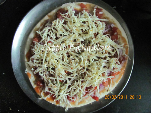 Grated cheese on pizza base