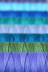 Stitcher's palette (jillyspoon) Tags: thread cotton sewing colours blues greens macro wrapped reels bobbin bobbins reel gutermann stitching line row depthoffield linedup canon canon60d 60d length flickrduel
