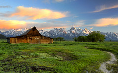 Sunrise at the Moulton Barn (Deby Dixon) Tags: morning history tourism water grass barn sunrise landscape photography interesting travels nikon bravo stream adventure wyoming tetons deby allrightsreserved grandtetonnationalpark 2011 mormonrow naturephotographer moultonbarn travelphotographer flickrdiamond debydixon famousbarn debydixonphotography
