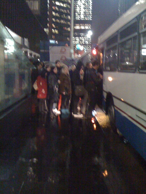 Queue for the bus in the rain