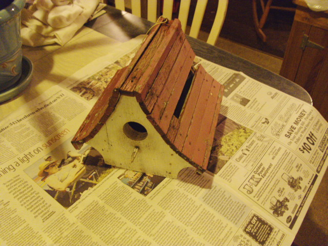 A birdhouse that's seen better days...