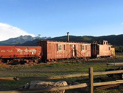 Living in an old train, USA (Pixmac_si) Tags: summer usa sun mountains nature sunshine weather truck landscapes daylight coach rocks seasons horizon unitedstatesofamerica bluesky trains nobody hills daytime summertime caravan naturalworld wagons exteriors waggons mountainpeaks summits oldtrains abandonedtrains tipofthehills livedintrain