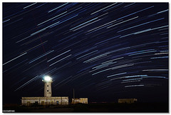 Capo Murro di Porco, Plemmirio, Syracuse - Under the stars (ciccioetneo) Tags: trip summer vacation sky italy lighthouse holiday speed marina stars faro nikon marine long exposure italia slow view angle wide creative reserve sigma commons cc journey creativecommons area shutter syracuse sicily 1020mm starry sicilia siracusa protected startrail riserva plemmirio capomurrodiporco d7000 areamarinaprotettadelplemmirio ciccioetneo penisoladellamaddalena farodicapomurrodiporco capomurrodiporcolighthouse