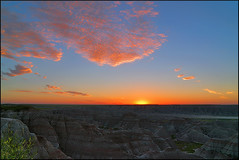 Badlands Sunrise (wellscenephotography (ON)) Tags: morning travel blue light summer vacation sky orange usa sun color nature colors southdakota sunrise wow landscape geotagged us photo interesting nikon scenery neon raw unitedstates bright vibrant horizon rich scenic gap dramatic july vivid poetic canyon fave adventure photograph summertime f22 fav badlands nikkor dslr hdr mothernature goldenhour badlandsnationalpark 18mm 18105 2011 singleimagehdr d5000 073111 gap201109 gapreview gapreview001 gapselected