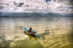 Rowing on the clouds (Nejdet Duzen) Tags: trip travel cloud lake reflection turkey boat trkiye sandal bursa bulut gl yansma turkei seyahat uluabatlake glyaz uluabatgl saariysqualitypictures mygearandme
