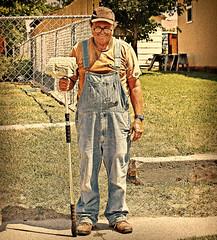 STIHL MAN (FotoEdge) Tags: summer portrait work happy town paint gritty brush jeans painter sweat overalls worker sidewalks saintjoseph missouririver coveralls resident stihl 2011 fotoedge