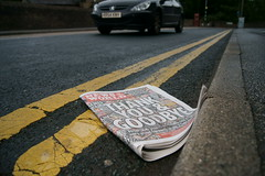 Thrown Into The Gutter (Elliot young) Tags: world people news car yellow last paper reading newspaper phone you good no lies down line read litter drain thank more rebekah and law years goodbye hack bye now scandal issue hacking rupert murdoch brooks 168 the notw of stoires acused allegations168