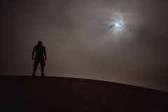 Desert Marauder (TheFella) Tags: africa portrait moon selfportrait man male sahara silhouette night clouds self dark sand desert northafrica dunes dune moonlit morocco figure marrakech maghreb moonlight sanddune zagora sanddunes kingdomofmorocco thefella zagoradesert conormacneill