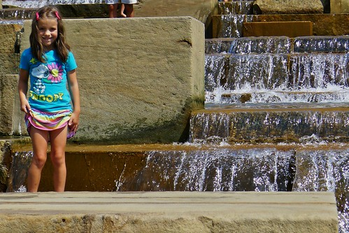 Texas Invasion:  Lauren splashing in the fountain.