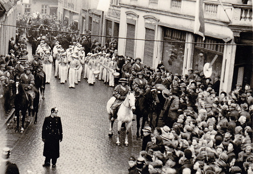 Carnival parade with historical costumes. 1950s Germany? Unidentified town.