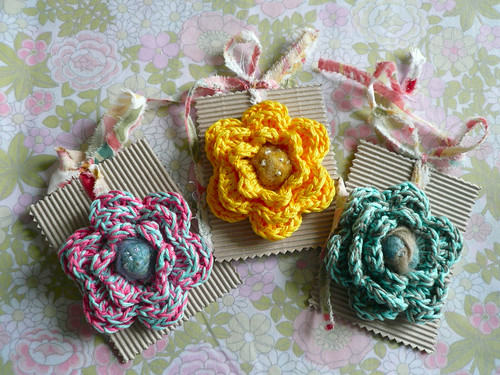 3 flower brooches on card