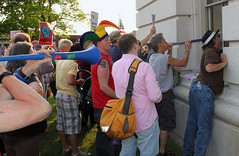 protesters in Madison, Wisconsin (Lori Greig) Tags: signs window colors hat sign wisconsin bill colorful budget politics union rally protest hats horns capitol governor walker madison wi controversial organizedlabor