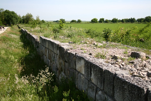 This is the surrounding wall of an immense medieval settlement identified as the first Bulgarian capital, Pliska. In fact, there is no factual evidence that connects the site with the name Pliska or any of the historical records about it.