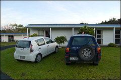 Our 2 cars in front of the Ninety Miles Beach Holiday Park cabin