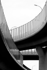 mix (Daniel Kulinski) Tags: road street city urban blackandwhite bw white abstract black monochrome car tarmac speed way concrete highway europe image 10 transport under central shapes evil samsung poland move minimal line communication ten warsaw civic minimalism simply asphalt minimalistic beton fas nx urbanshapes noclolor samsungimaging nx10 samsungnx10 gettypoland1