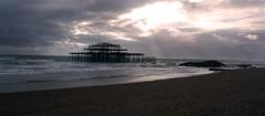 Old Brighton pier (ChrisUK27) Tags: old blue sea england sun seagulls white black english water fire grey pier brighton flickr waves cloudy decay damage damaged corrosion channel qcean mygearandme