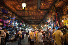 The Souks of Marrakech (TheFella) Tags: africa roof light people slr night digital photoshop canon shopping eos evening photo high dynamic market northafrica crowd markets morocco nighttime photograph processing marrakech maghreb souk 5d bags handbags dslr rugs souks range hdr highdynamicrange stalls crowded markii postprocessing traders djemaaelfna photomatix kingdomofmorocco hdrs suuqs 5dmarkii