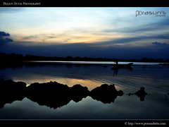 Heavenly Solitude (PrasunDutta) Tags: blue sunset sky cloud india reflection tree silhouette boat nikon colorphotography kws fishery westbengal d90 prasun rajarhat nikond90 north24parganas kolkataweekendshoots prasundutta kharibari kwsian prasunsphotography