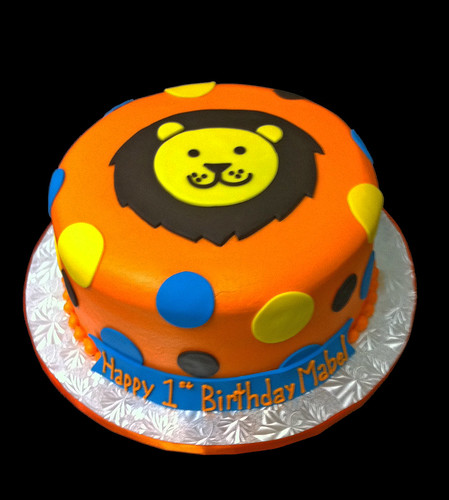 1st birthday lion cake orange yellow blue and brown