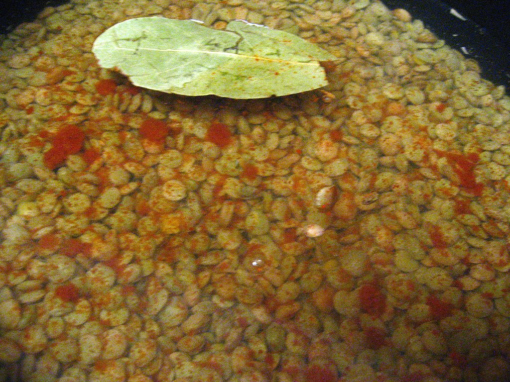 Lentils boil in cayenne with a bay leaf