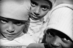 three small eyes  in the abandoned villages of the region Thiama-yemen (anthony pappone photography) Tags: travel portrait people blackandwhite blancoynegro girl barn digital canon pose children photography photo blackwhite eyes child bambini expression retrato picture hijab culture arab portraiture arabia childrens littlegirl yemen ritratto blackgirl reportage photograher barna phototravel etnico etnia arabie bambine etnologia childrentravel arabiafelix arabianpeninsula portraitsofchildren eos5dmarkii thiama childrenbestphotos