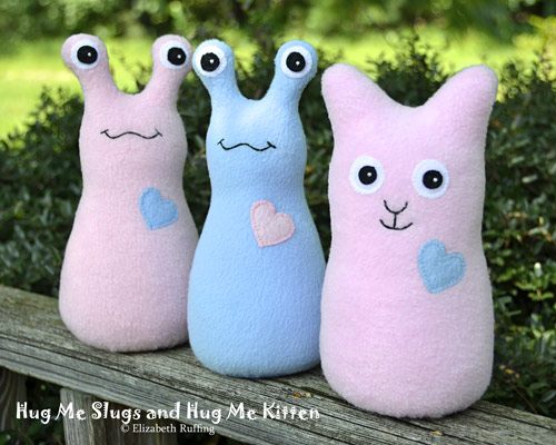 Pink and light blue fleece Hug Me Slugs and Hug Me Kitten by Elizabeth Ruffing