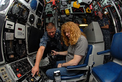 NC native/Sailor explains the ship\'s control panel to Dave Mustaine, lead singer of the band Megadeth