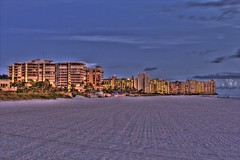Marco Island (johnmiseroy) Tags: ocean pink blue sunset orange color beach beautiful yellow canon landscape photography eos purple filter hdr 28300mm marcoisland photomatix tonemapping singhray t2i varintrio