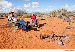 Boiling the billy. Australia. (john white photos) Tags: red camp dog fire sitting desert tea seat relaxing australia billy outback remote southaustralia woomera