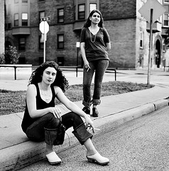 Osinsky Sisters Smoking On Curb 3 (neohypofilms) Tags: street city girls portrait urban bw classic 120 film june sisters contrast corner vintage hair necklace beads shoes downtown candid cleveland grain poland polish gritty retro smoking sidewalk jeans curly 70s clogs heels denim medium format casual pearl females grainy curb mules platforms cigerette 2011 neohypofilms hassalbald