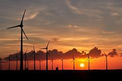 A quiet evening in June (powerfocusfotografie) Tags: sunset sky netherlands clouds landscape mood wind silhouettes windmills electricity groningen henk turbines windturbines greenenergy turbinaselicas windenergie eemshaven aeolus nikond90 energyvalley 100commentgroup powerfocusfotografie mygearandme