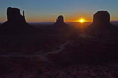 Heaven's Whispers (dbushue) Tags: road morning arizona sky sun southwest nature sunrise dark landscape dawn scenery rocks butte valley monumentvalley lightness mittens navajotribalpark 2011 coth supershot naturesgarden absolutelystunningscapes damniwishidtakenthat coth5 dailynaturetnc11