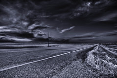 Blackened skies over an open road (Fistfulofpowder) Tags: road county blackandwhite black monochrome clouds grey highway empty tripod powerlines lonely monday asphalt powerpole hdr highdynamicrange camrose nikond300s rosalindalberta