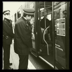 Bendy bus cops (digitalesse) Tags: cameraphone blackandwhite london westminster square candid westend iphone iphoneography iphone3gs hipstamatic