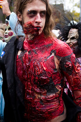 ZombieWalk--37 (ZZ11) Tags: park eve boy red people woman toronto man art halloween girl flesh canon children dead army rebel march kid blood woods october all child force bell zombie walk evil police trinity brains gore bones undead mm 105 35 31 guts hallows task resident 2011 550d t2i