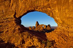 Sunrise at Window Arch (Michael Riffle) Tags: autumn southwest window nature sunrise canon landscape utah nationalpark day arch desert sunny arches clear moab redrock archesnationalpark turret coloradoplateau desertsouthwest turretarch 2011 windowarch
