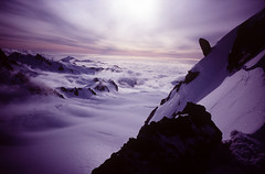 waves of clouds crashing against the glacier. (SigurC) Tags: new sunset minolta photographers first velvia zealand 100 try beginner tc1 alpineclimbing minoltatc1