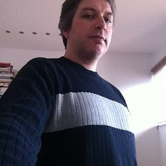 Wearing my sandman jumper.